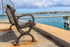 Vintage bench by the ocean Royalty Free Stock Photography
