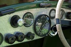 Vintage Bentley dashboard. In turned aluminum with string wrapped steering wheel stock image