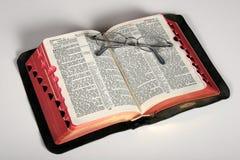 Vintage Bible with eyeglasses Stock Photos
