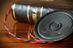 Vintage Bible with an old audio speaker stock photography