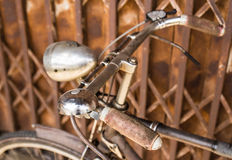 Vintage bicycle against an old metal wall Stock Photography