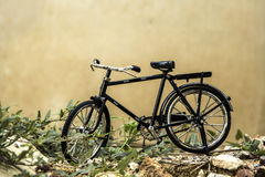 Vintage bicycle. Area wastelands filled with weeds and old walls Royalty Free Stock Images