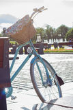 Vintage bicycle with basket near the sun park. And fontain Royalty Free Stock Photos