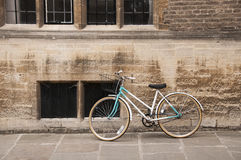 Vintage Bicycle at Cambridge, UK. A vintage style bicycle leaning against a college wall at Cambridge, UK Royalty Free Stock Image