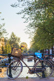 Vintage bicycle in dutch canal cityscape Stock Photography