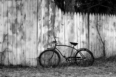 Vintage bicycle on the fence Royalty Free Stock Photography