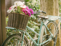 Vintage bicycle with flowers in basket Stock Photo