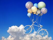 Free Vintage Bicycle Flying Up Into The Sky With Balloons Royalty Free Stock Photo - 174150405