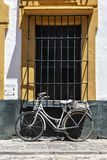 Vintage bicycle in front of the old house stock photos