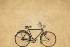 Vintage bicycle in front of a sepia background Stock Photos