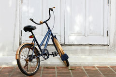 Vintage bicycle. In front of Thai architecture white door Royalty Free Stock Photo