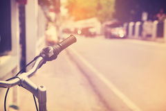 Vintage Bicycle Handlebar Resting in the city Street Royalty Free Stock Image