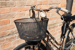 Vintage Bicycle Leaning against a Stone Wall Royalty Free Stock Photos