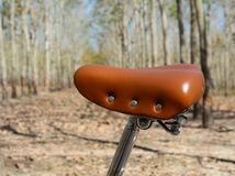 Vintage bicycle leather saddle stock photography