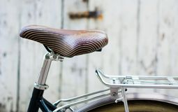 Vintage bicycle leather seat close up. Vintage bicycle with leather seat close up Royalty Free Stock Images