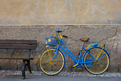 Vintage bicycle near wooden bench Stock Images