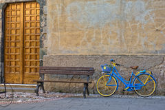 Vintage bicycle near wooden bench Royalty Free Stock Images
