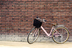 Vintage bicycle with old brick wall Royalty Free Stock Image