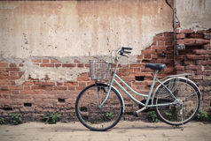 Vintage bicycle with old brick wall Royalty Free Stock Photos