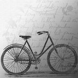 Vintage bicycle with an old letter. Vintage bicycle design on an old papper with a letter on background Stock Photo
