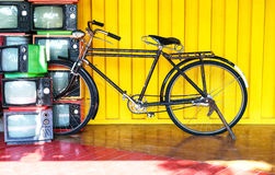 Vintage bicycle and old TV. Stock Photo