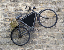 Vintage Bicycle on Old Wall Stock Photos