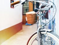 Vintage bicycle parking lean on the house wall. Summer vintage concept stock image