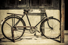 Vintage bicycle parking at old house Royalty Free Stock Image