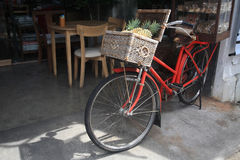 Vintage bicycle with pineapple on the basket Stock Image