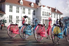 Vintage Bicycle. Pink and blue old fashioned bicycle seen at old town tourist attraction in Central of Jakarta, Indonesia Stock Photo