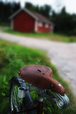 Vintage bicycle with the seat at a rural road Stock Images