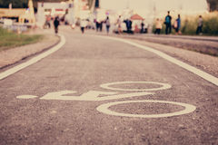 Vintage bicycle sign on road, Bicycle path. View forward a long road, The road made form Asphalt cement stock photography