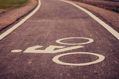 Vintage bicycle sign on road, Bicycle path. View forward a long road, The road made form Asphalt cement stock photos