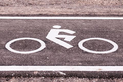 Vintage bicycle sign on road, Bicycle path. View from side road, The road made form Asphalt cement Royalty Free Stock Photography