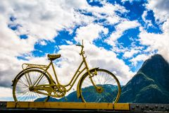 Vintage bicycle stands on a bridge, in the background of a mount Royalty Free Stock Images