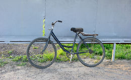 Vintage Bicycle. A vintage-style bicycle leaned on metal wall stock image