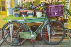 Vintage bicycle with table and garden plants in Amsterdam Stock Photos