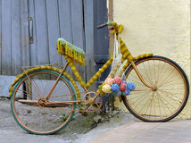 Vintage bicycle tied with thread and balls of woolen thread. The yard of the shop crafts, Grodno, Belarus Royalty Free Stock Image