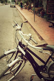 Vintage Bicycle Travel Resting in the city Street. Royalty Free Stock Photos