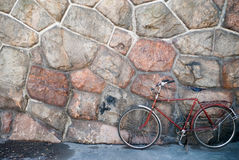 Vintage bicycle on wall background Royalty Free Stock Photos