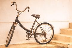 Vintage bicycle, wall, background royalty free stock image