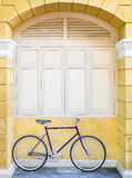 Vintage bicycle on Wall Window frame Hipster lifestyle stock photos