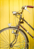 Vintage bicycle on wall Stock Photos