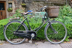 Vintage Bicycle. Wells, UK - August 30, 2014: View of a vintage Pashley Princess bicycle parked outside a cottage Royalty Free Stock Photo