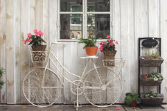 Vintage bicycle. On vintage white wooden house wall Royalty Free Stock Image