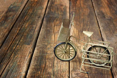 Vintage bicycle on wooden textured background. nostalgic concept. Stock Photo