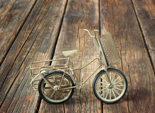 Vintage bicycle on wooden textured background. nostalgic concept. Royalty Free Stock Photos