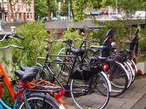 Vintage bicycles in Amsterdam. Canal Royalty Free Stock Image