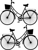 Vintage bicycles, black silhouetteon a white background,  Royalty Free Stock Image