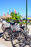 Vintage bicycles parked against sand dunes by the beach.Kos island ,Greece Stock Photo